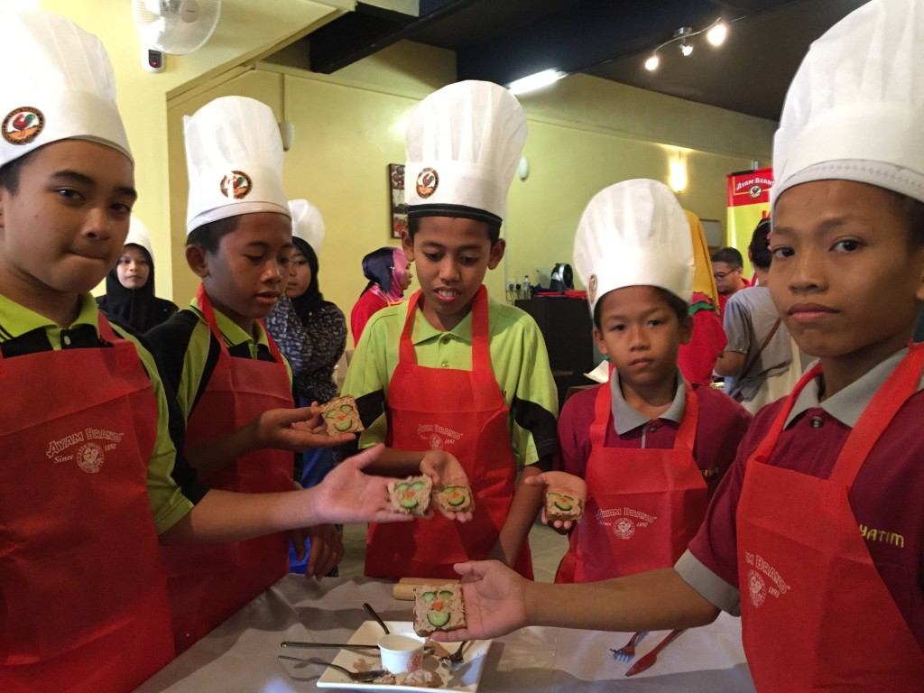 """I can do it!"" Children from PEKA Yatim presenting their dishes from the  Ayam Brand Kids Can Cook Class"