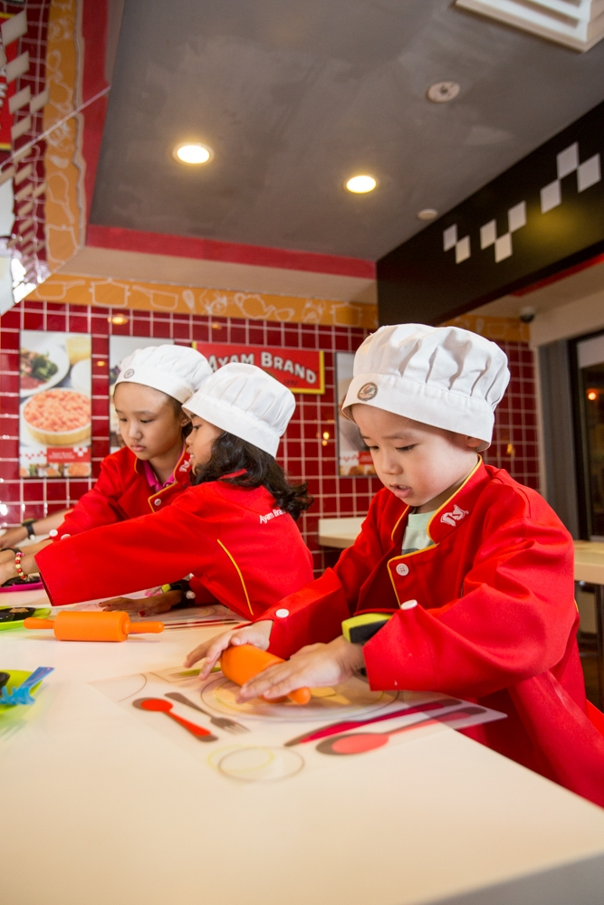 Children engaged in one of the interesting activities offered in Ayam Brand™ Cooking School, Kidzania