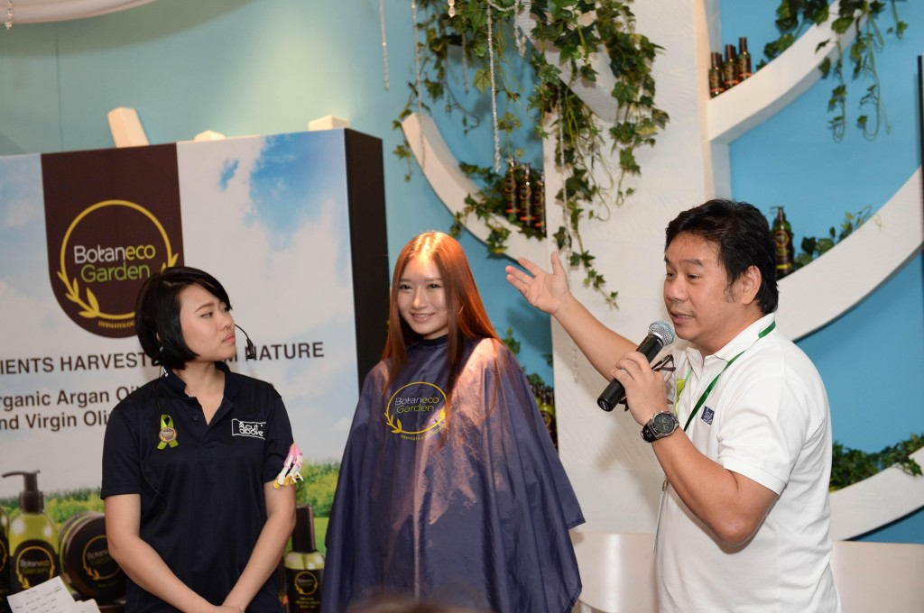 Mr. Peter Wong (right),  Head of Academy, A Cut Above, sharing hair care tips using the Botaneco Garden Organic Argan & Virgin Olive Oil Hair Collection