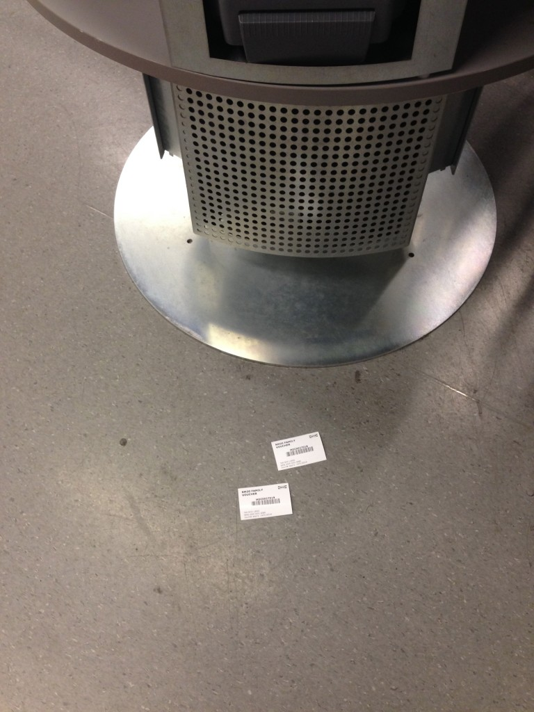 Vouchers I redeemed through self-help kiosk.  Dropped to the floor.  Was searching for them at first, as the place was really crowded