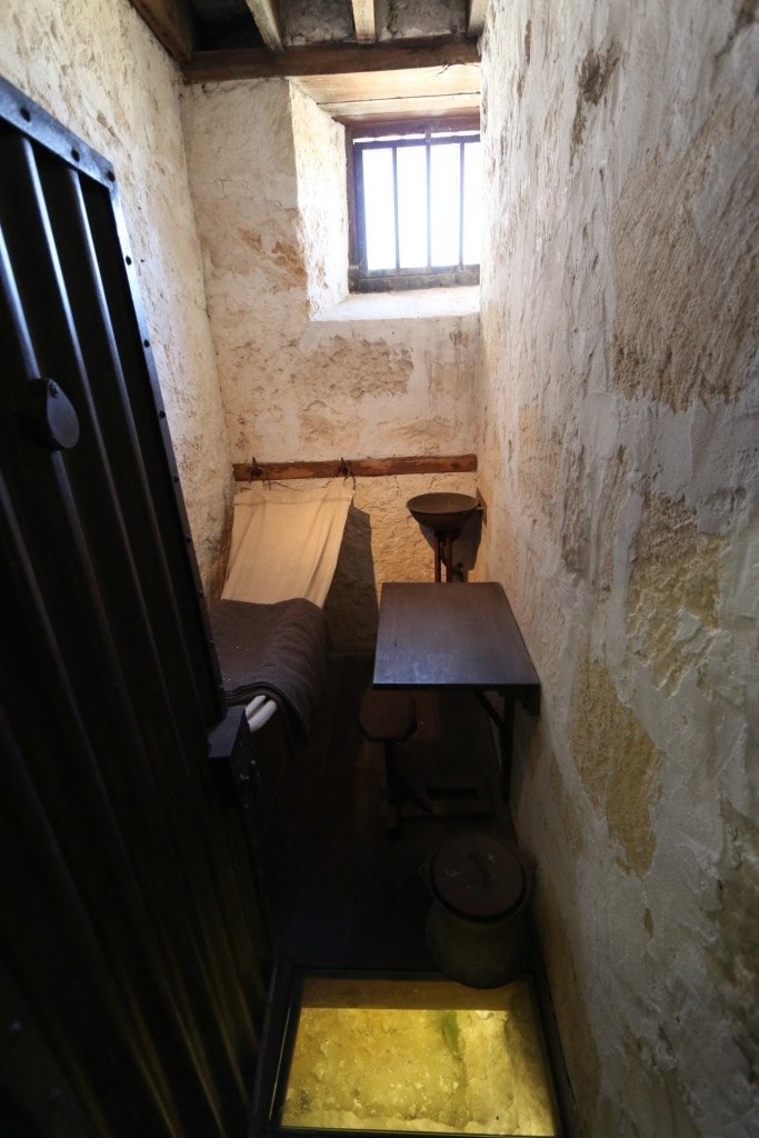 How tiny the prison cell is.