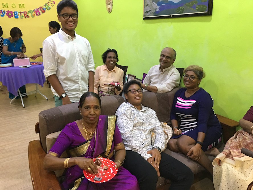 Mother was busy feeding the birthday cake for everyone, with Mr. Jaya and spouse, who both used to teach all Vijayans