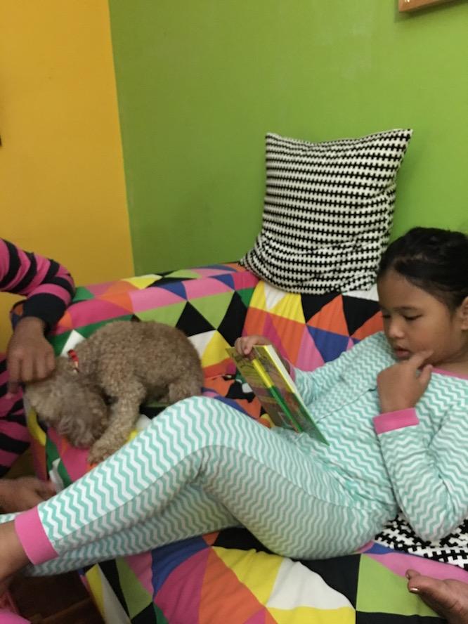 Inez, reading a story to Manikam