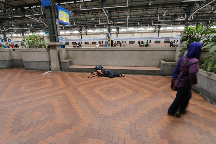 A homeless person, sleeping soundly at the station
