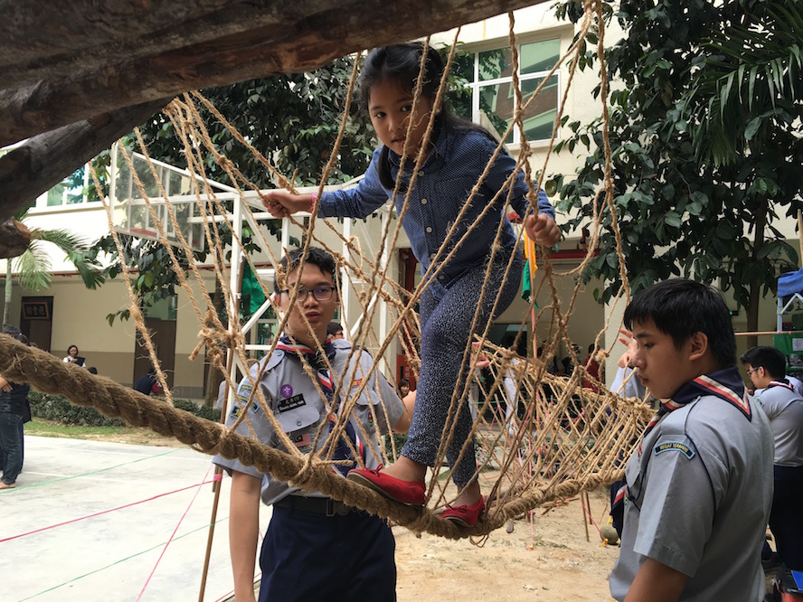 Ms Tan, crossing the Monkey Bridge