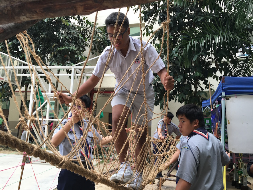 Mr. Tan, crossing the Monkey Bridge