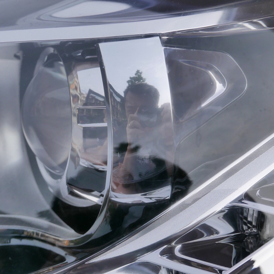 Me, with Leica in reflection on Citroen DS5 head lamp