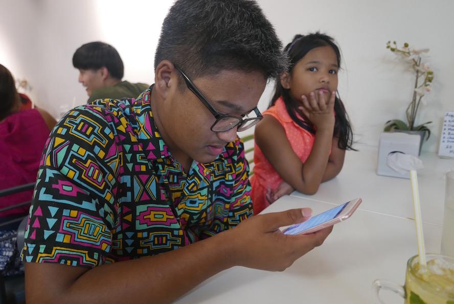Elijah, reading a Kanye-IKEA meme which Retna shared with us