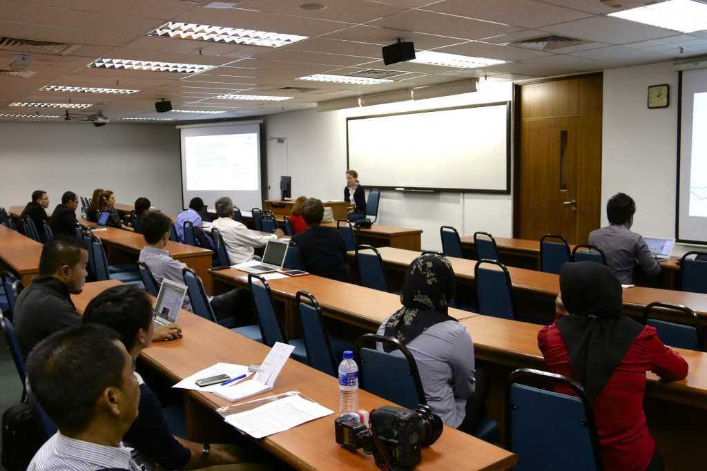 Participants listen attentively as Ms Ekaterina presents her thoughts on being a linguist in a DLP industry.