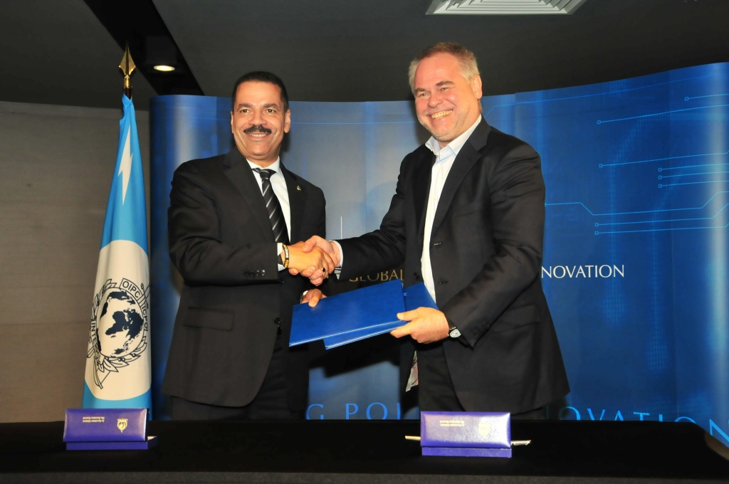 (From Left) Ronald K. Noble, INTERPOL Secretary General, and Eugene Kaspersky, Chairman and CEO of Kaspersky Lab, with the signed agreements