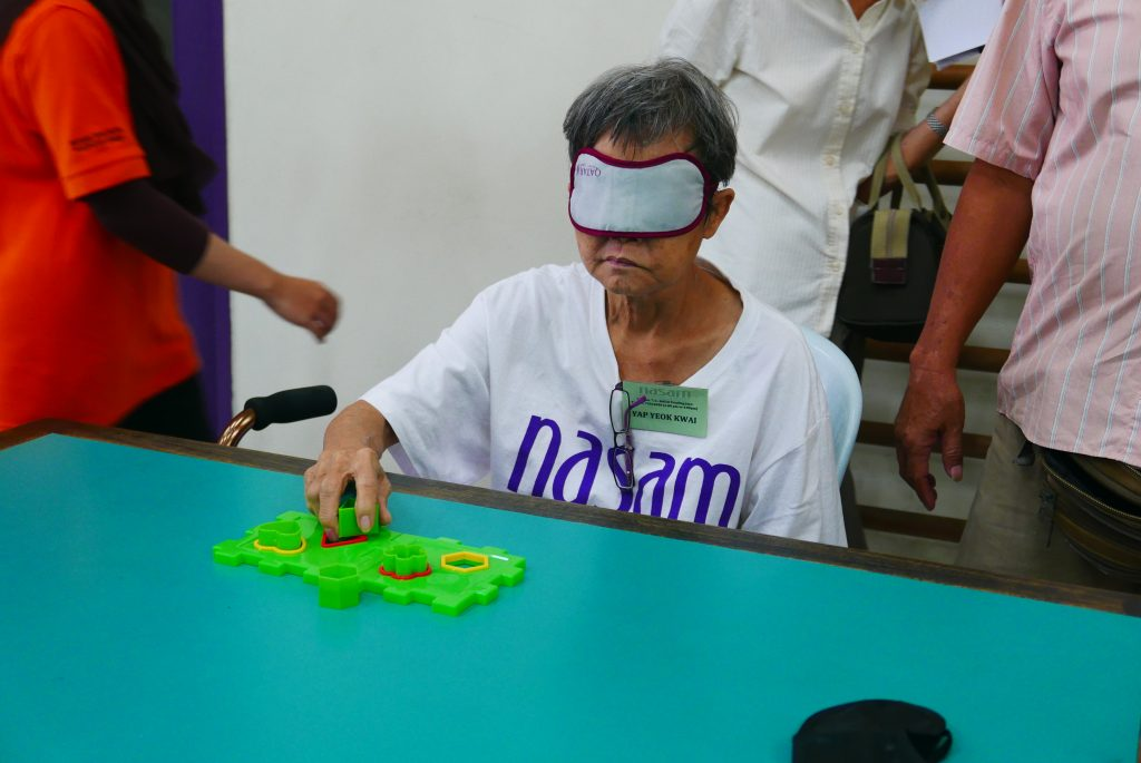 Participant of NASAM Stroke Games arranging the puzzle based on touch and feel senses
