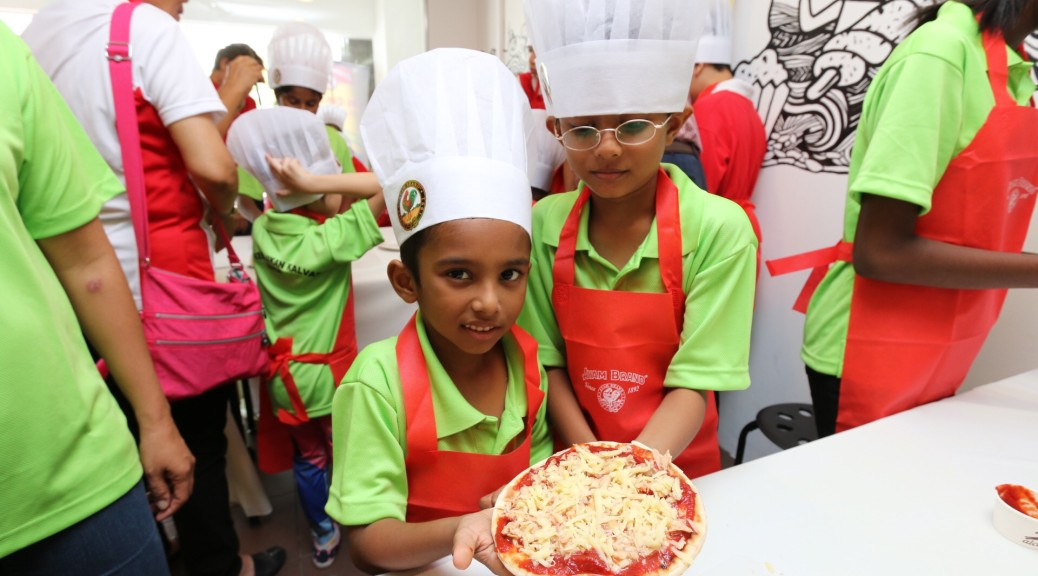 """I can do it!"" Children from Calvary Home presenting Ayam Brand Tuna Pizza."