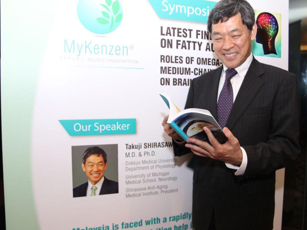 "Professor Shirasawa  from the Department of Ageing Control Medicine, Juntendo University with newly launched ""Food For The Brain"", a health and recipe book to promote brain health in reducing effects of dementia such as Alzheimer's disease"